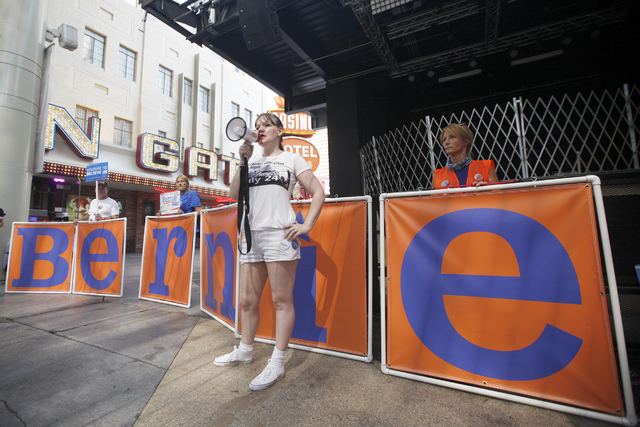 Jenna Garrett, organizer for the march, addresses Sanders supporters at the March For Bernie USA demonstration at the Fremont Street Experience in downtown Las Vegas on Sunday, July 24, 2016. (Rac ...