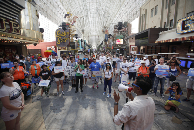 Reuben D'Silva, a candidate for Congress in District 1 as Independent, addresses Sanders supporters at the March For Bernie USA demonstration at the Fremont Street Experience in downtown Las Vegas ...