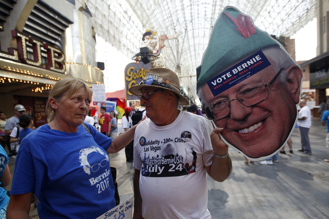 Stephanie King, left, talks to Ronny Wolf at the March For Bernie USA demonstration at the Fremont Street Experience in downtown Las Vegas on Sunday, July 24, 2016. (Rachel Aston/Las Vegas Review- ...