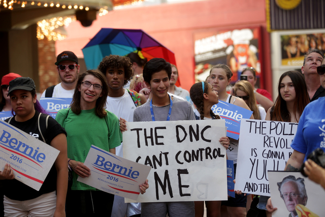 Bernie Sanders supporters listen to a speaker at the March For Bernie USA demonstration at the Fremont Street Experience in downtown Las Vegas on Sunday, July 24, 2016. (Rachel Aston/Las Vegas Rev ...