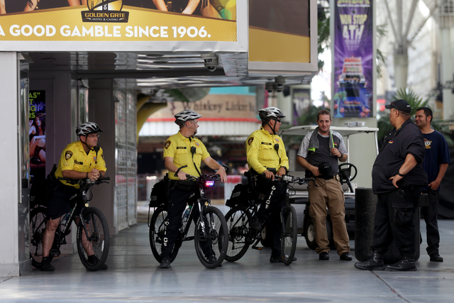 Fremont Street Experience security members stand by at the March For Bernie USA demonstration at the Fremont Street Experience in downtown Las Vegas on Sunday, July 24, 2016. (Rachel Aston/Las Veg ...