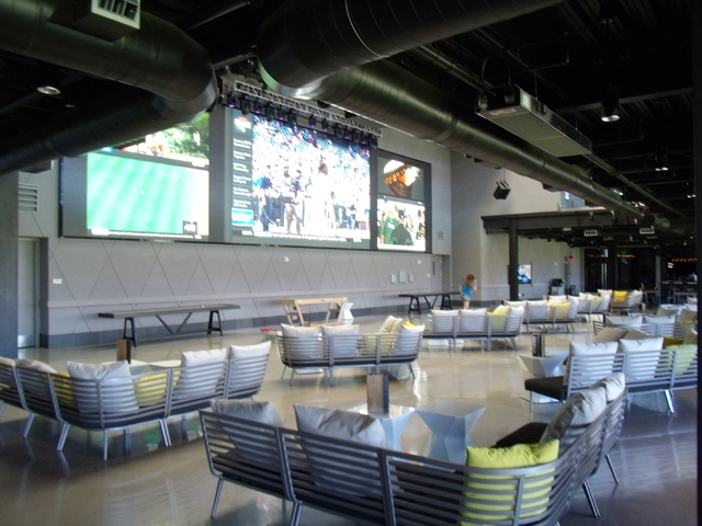Large-screen TVs broadcast games at Topgolf, 4627 Koval Lane. John Asay/Special to View