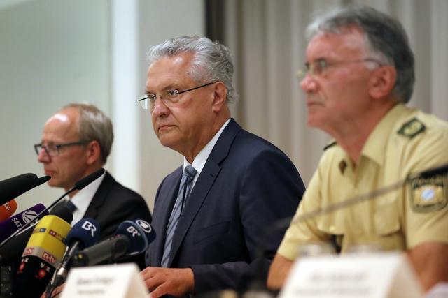 Bavarian Interior Minister Joachim Herrmann, center, briefs the media in Ansbach, Germany, Monday, July 25, 2016.  (Matthias Schrader/Associated Press)
