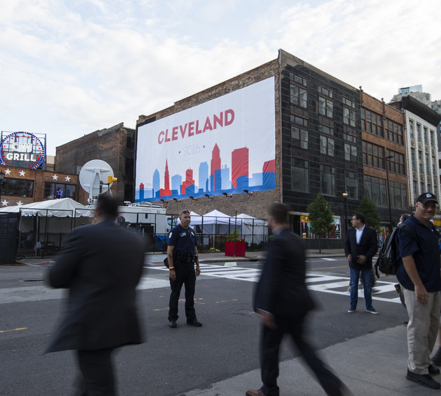People walk along Prospect Avenue ahead of the Republican National Convention in Cleveland on Saturday, July 16, 2016. (Chase Stevens/Las Vegas Review-Journal) Follow @csstevensphoto