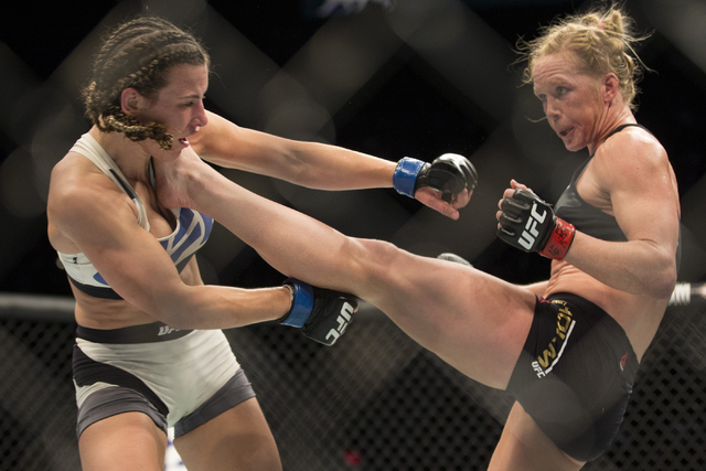 Holly Holm, right, connects a kick against Miesha Tate in their women's bantamweight title bout during UFC 196 at MGM Grand Garden Arena on March 5, 2016, in Las Vegas. Holm, who lost the fight, ...