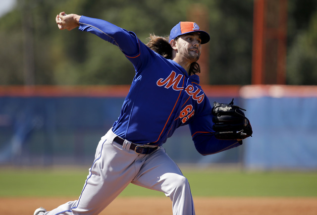 New York Mets pitcher Robert Gsellman throws during live batting practice at spring training baseball workout Saturday, Feb. 27, 2016, in Port St. Lucie, Fla. (Jeff Roberson/AP)