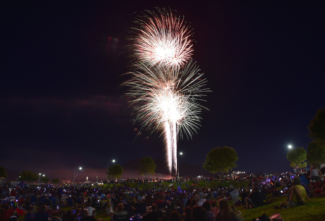 People watch the annual fireworks show during the Fourth of July celebration at Mission Hills Park Monday, July 4, 2016, in Henderson. David Becker/Las Vegas Review-Journal Follow @davidjaybecker