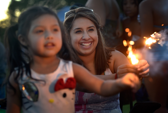Wendy De La Rosa, right, and her daughter, Ashley, 3, play with sparklers during the Fourth of July celebration at Mission Hills Park Monday, July 4, 2016, in Henderson. David Becker/Las Vegas Rev ...