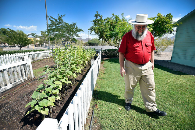 Clark County museums administrator Mark Hall-Patton walks by a garden behind a 1941 Henderson Townsite home during a tour at the Clark County Museum Tuesday, July 26, 2016, in Henderson. David Bec ...