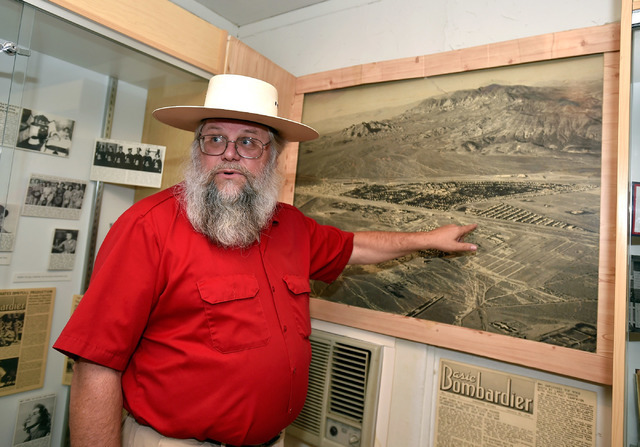 Clark County museums administrator Mark Hall-Patton points out a early an aerial photograph of Henderson during a tour at the Clark County Museum Tuesday, July 26, 2016, in Henderson. David Becker ...