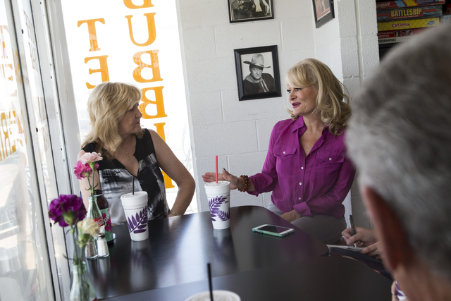 Denell Hahn, left, and Valerie LaPorta, directors for the Henderson Historical Society, speak about the purpose of the organization during an interview at Coo Coo's Gourmet Coffee Cafe on Wednesda ...