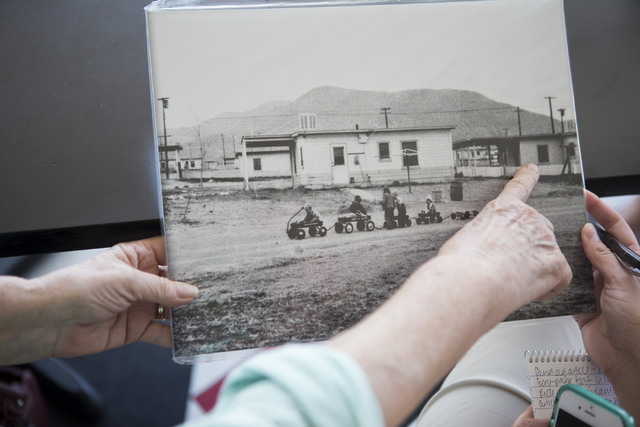 Lynn Marie Starr, director for the Henderson Historical Society, shows a picture of her current home in the 1940s in Henderson during an interview about the historical society at Coo Coo's Gourmet ...