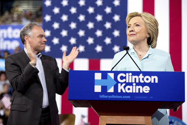 Hillary Clinton accompanied by Sen. Tim Kaine, D-Va., left, speaks at a rally at Florida International University Panther Arena in Miami, Saturday, July 23, 2016. (Andrew Harnik/The Associated Press)