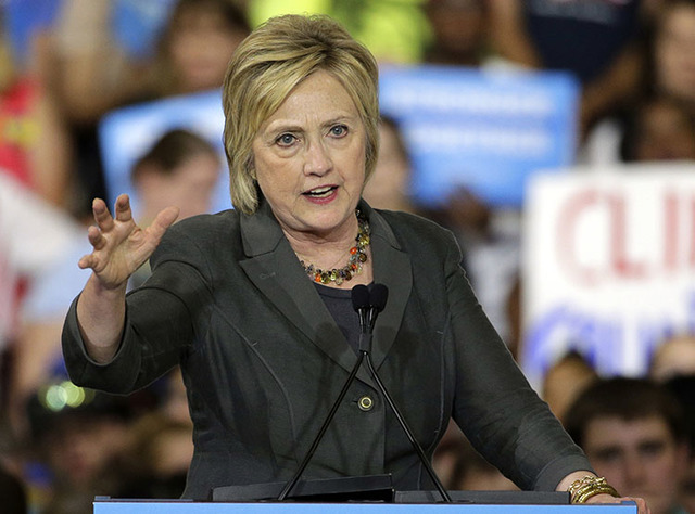 Hillary Clinton gestures as she speaks during a rally in Raleigh, N.C.,. on June 22. (Chuck Burton/The Associated Press)