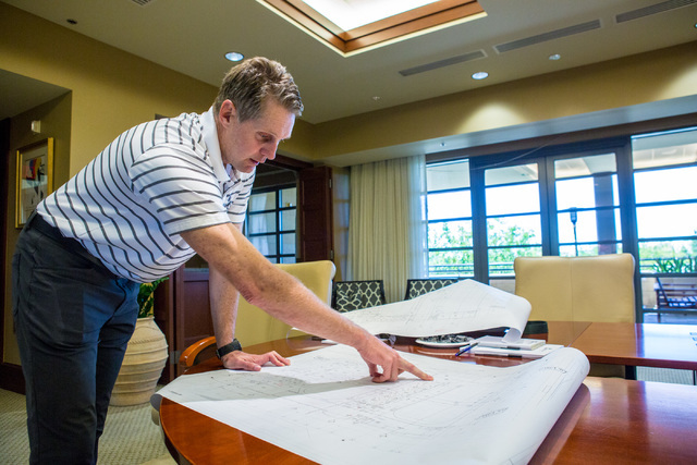 Murray Craven shows ice rink plans for the new Las Vegas NHL team Wednesday, July 20, 2016, during an interview in the Fidelity National Financial offices in Summerlin. Craven is helping owner Bil ...