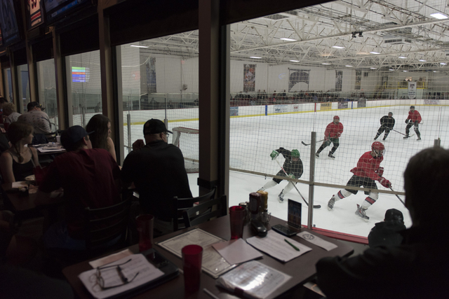 Brooksy's Bar & Grill patrons watch youth hockey teams play a game at Las Vegas Ice Center during a conference in which the NHL's Board of Governors announced approval of an expansion franchis ...