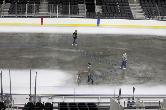 Ice installers lay the first layer of white ice onto the NHL rink at the T-Mobile Arena in Las Vegas on Saturday, June 30, 2016. (Loren Townsley/Las Vegas Review-Journal) Follow @lorentownsley