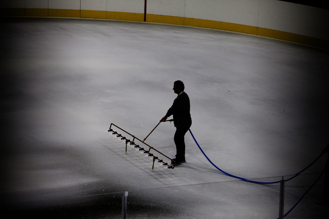George Salami, the T-Mobile Area conversion manager, sprays the first layer of white ice onto the NHL rink on Saturday, June 30, 2016, at the T-Mobile Arena in Las Vegas. (Loren Townsley/Las Vegas ...