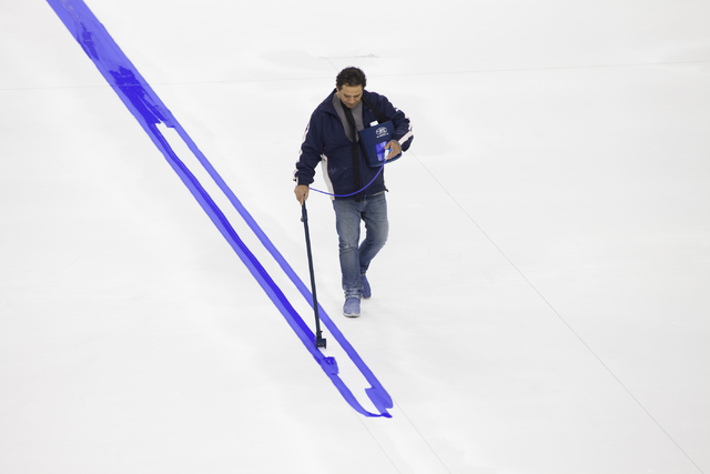 George Salami, the T-Mobile Area conversion manager, starts painting onto the NHL rink on Saturday, June 30, 2016, at the T-Mobile Arena in Las Vegas. (Loren Townsley/Las Vegas Review-Journal) Fol ...