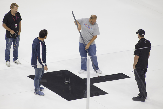 Ice installers start painting onto the NHL rink on Saturday, June 30, 2016, at the T-Mobile Arena in Las Vegas. (Loren Townsley/Las Vegas Review-Journal) Follow @lorentownsley