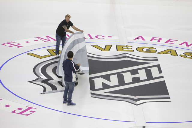 Ice installers start laying out the logo for the NHL rink on Saturday, June 30, 2016, at the T-Mobile Arena in Las Vegas. (Loren Townsley/Las Vegas Review-Journal) Follow @lorentownsley