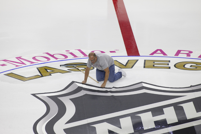 An ice installer lays out the logo for the NHL rink on Saturday, June 30, 2016, at the T-Mobile Arena in Las Vegas. (Loren Townsley/Las Vegas Review-Journal) Follow @lorentownsley