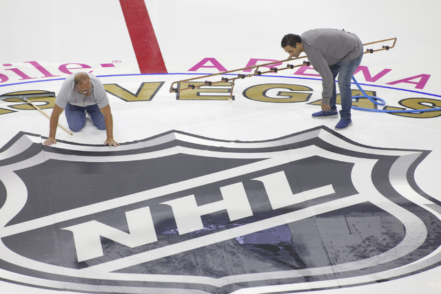 Ice installers lay out the logo for the NHL rink on Saturday, June 30, 2016, at the T-Mobile Arena in Las Vegas. (Loren Townsley/Las Vegas Review-Journal) Follow @lorentownsley