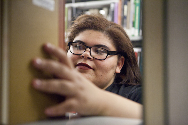 Theresa Butler, 17, looks through the books at the Lied Library at the University of Nevada, Las Vegas on Friday, June 8, 2016. (Loren Townsley/Las Vegas Review-Journal) Follow @lorentownsley