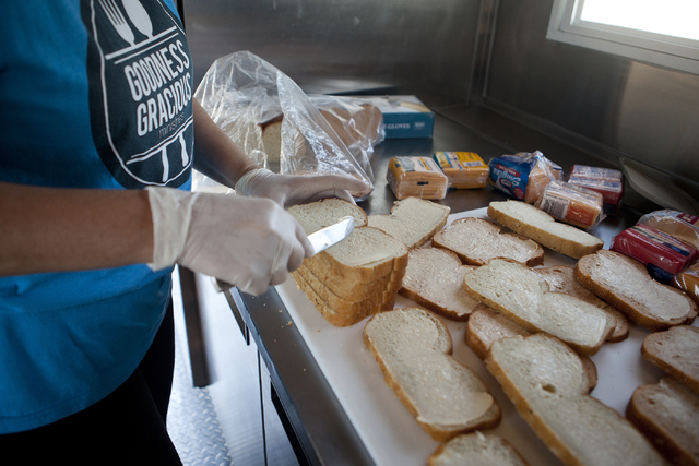 Goodness Gracious Ministries founder Jenny Bland makes grilled cheese sandwiches for the homeless July 19 in Las Vegas. Loren Townsley/View