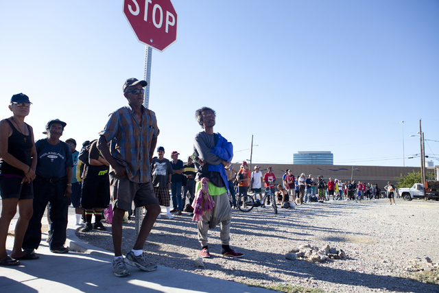 A line homeless people wait for Goodness Gracious Ministries, a food truck that feeds the homeless, July 19 on the corner of G Street and McWilliams Avenue in Las Vegas. Loren Townsley/View
