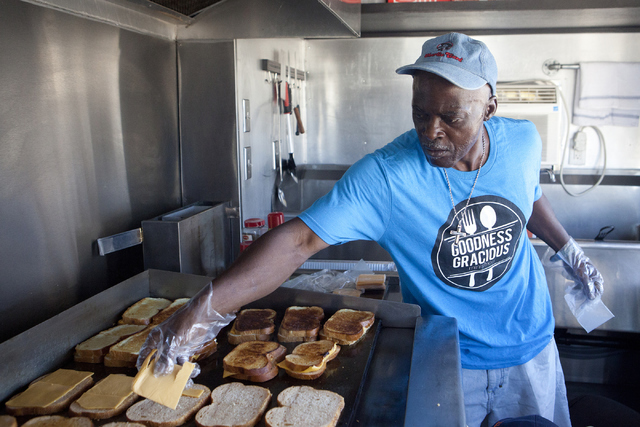 Kevin Harris makes grilled cheese sandwiches for the homeless July 19 in the Goodness Gracious Ministries food truck. Loren Townsley/View