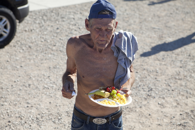 A homeless man waits in line for coffee and water provided by Goodness Gracious Ministries on the corner of G Street and McWilliams Avenue in Las Vegas July 19. Loren Townsley/View