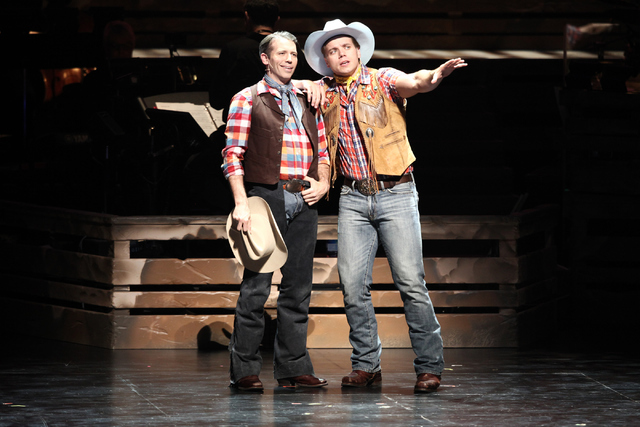 "Best pals Slim Johnson (Matt Loehr), left, and Whip Masters (Nathaniel Hackmann) extol the virtues of the spudbusting life in ""Idaho! The Comedy Musical,"" which continues at The Smith Center throu ..."