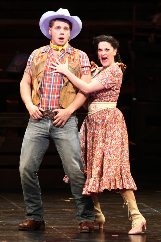 "Spudbuster Whip Masters (Nathaniel Hackmann), left, and Crazy Betty Felter (Holly Holcomb) join the opening number, ""Heck It's A Helluva Day,"" during The Smith Center's ""Idaho! The Comedy Musical. ..."