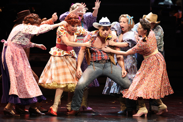 "Whip Masters (Nathaniel Hackmann), center, joins fellow Idahoans to celebrate the fact that ""Heck It's A Helluva Day,"" the opening number in The Smith Center's new musical ""Idaho!"" Loren Townsley/ ..."