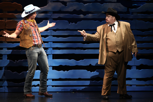 "Spudbuster Whip Masters (Nathaniel Hackmann), left, confronts local fat cat Jed Strunk (Paul Vogt) in musical ""Idaho!: The Comedy Musical,"" which continues at The Smith Center through July 17. Lor ..."