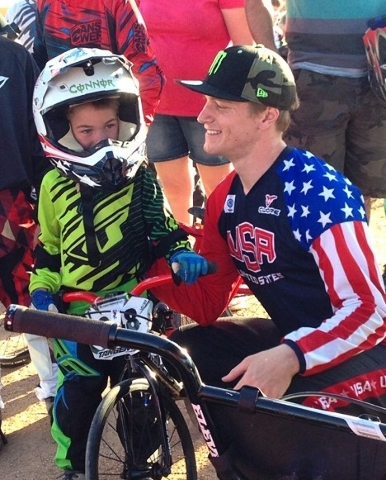 Local BMX rider Connor Fields, 22, talks with a younger cyclist. The Henderson resident attended the April 25 grand opening of the Whitney Mesa BMX Track, 1575 Galleria Drive. (Special to View)