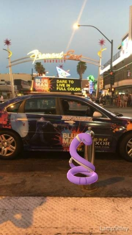 An Ekans is seen at the Fremont Street Experience on the screen of a Pokemon Go user in downtown Las Vegas, on Wednesday, July 13, 2016. (Ashley Casper/Las Vegas Review-Journal)