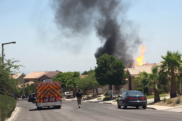Houses in the northwest Las Vegas Valley are being evacuated Tuesday after a backhoe hit a natural gas line, which caught fire, the Las Vegas Fire Department said. (Daniel Clark/Las Vegas Review-J ...