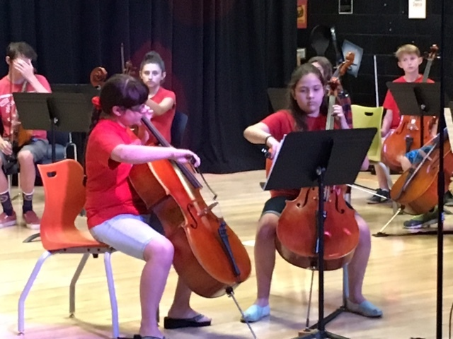 Two students perform at a summer recital at Henderson International School. The school is partnering with the Nevada School of the Arts to enhance music education. Special to View