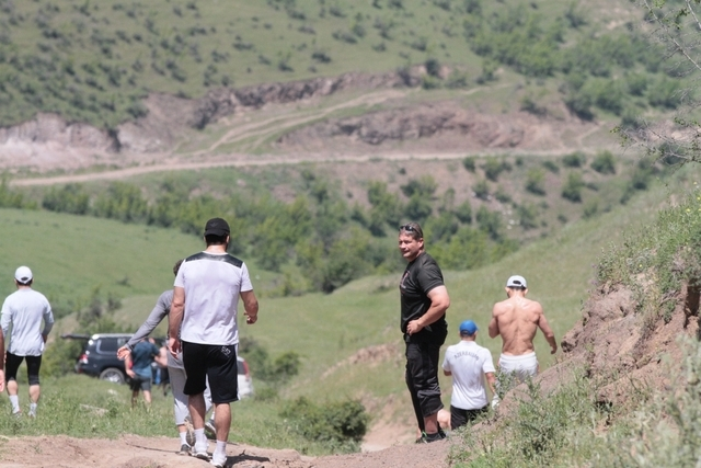 Local gym owner and former strongman Mark Philippi, black shirt, is shown during training session with the Azerbaijan Olympic wrestling team in the mountains near Goygol in Azerbaijan. (Courtesy M ...