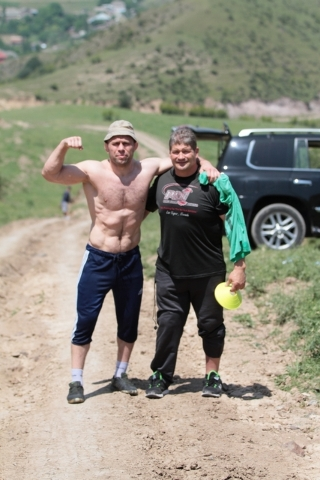 Local gym owner and former strongman Mark Philippi, right, is shown with  former world champion wrestler Khetag Gazyumov during training with the Azerbaijan Olympic wrestling team in the mountains ...