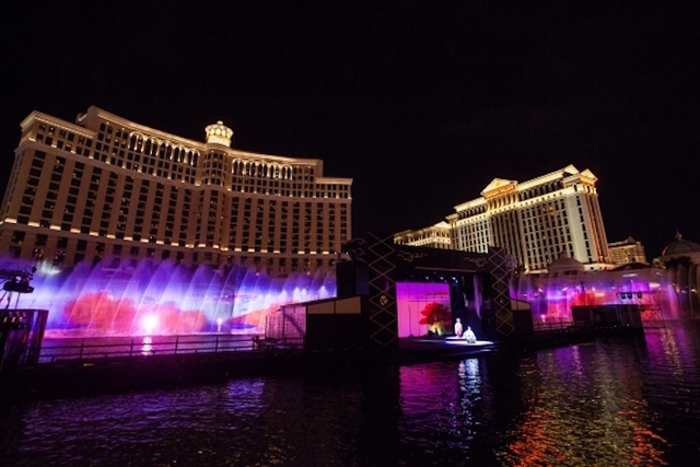 """An adapted version of the kabuki classic """"Koi Tsukami (Fight With a Carp)"""" is performed on a stage at the Bellagio fountains in Las Vegas on Friday, Aug. 14, 2015. (Chase Stevens/Las Vegas Review- ..."""