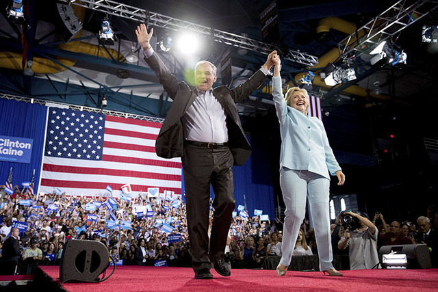 Hillary Clinton and Sen. Tim Kaine, D-Va., arrive at a rally at Florida International University Panther Arena in Miami, Saturday, July 23, 2016. (Andrew Harnik/The Associated Press)
