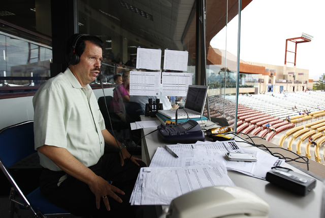 Russ Langer prepares to call game 4 of the Conference Championship Series for the radio channel KBAD 920 AM  in Las Vegas Saturday, Sept. 7, 2013.  (John Locher/Las Vegas Review-Journal)