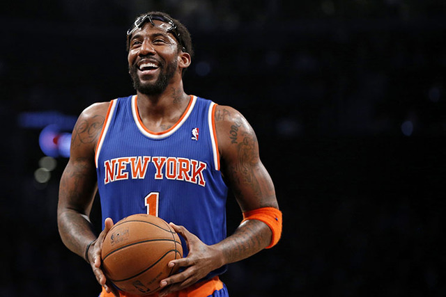 In this Dec. 5, 2013, file photo, New York Knicks forward Amare Stoudemire smiles before shooting a free throw during the team's NBA basketball game against the Brooklyn Nets in New York. Stoudemi ...