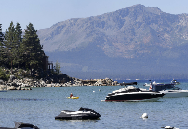 A kayaker paddles along Zephyr Cove, the sight of the 19th Annual Lake Tahoe Summit in south Lake Tahoe, Nevada, in 2015. (The Associated Press)