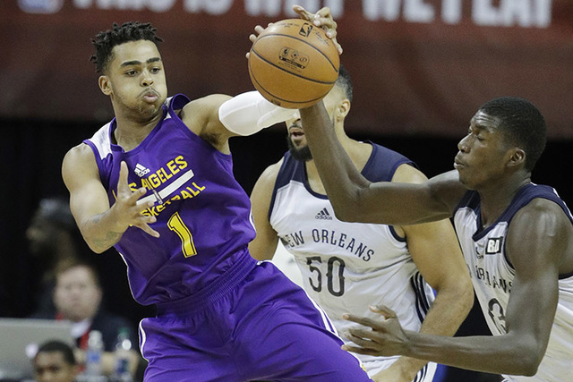 New Orleans' Cheick Diallo, right, and Los Angeles Lakers' DAngelo Russell battle for the ball during the second half of an NBA summer league basketball game, Friday, July 8, 2016, in Las Vegas. ( ...
