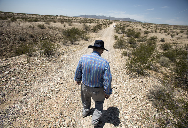 Jim Maniaci, president of the Laughlin Economic Development Corporation, walks on a graveled road on the southern end of Laughlin, Nev. on Thursday, July 28, 2016. Jeff Scheid/Las Vegas Review-Jou ...