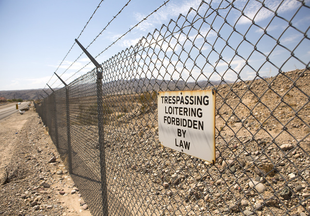 A sign is posted on a fence line at the site of the former Mojave Power Station is  seen Thursday, July 28, 2016 in Laughlin, Nev. Jeff Scheid/Las Vegas Review-Journal Follow @jeffscheid
